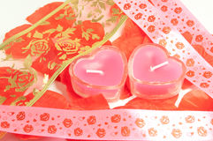 Candles in the form of hearts and tape Royalty Free Stock Images