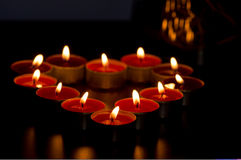Candles forming heart. Close up of candles lit only by them selves royalty free stock photos