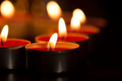 Candles forming heart. Close up of candles lit only by them selves royalty free stock photo
