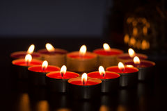 Candles forming heart. Only lit by thmselves on dark background stock photo