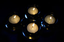 Candles. Four candles in the dark Royalty Free Stock Photos