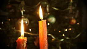 Candles in front of the Christmas tree stock footage