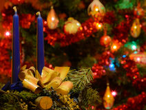 Candles in front of the Christmas tree Stock Images