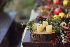 Candles and fruit Stock Photos