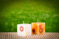 Candles on a garden background Stock Photography
