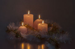 Candles in the garland dress. Atmospheric lighting with candles Royalty Free Stock Image