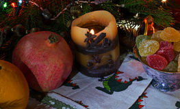 Candles and garlands,fruit, and marmalades. Candles and garlands,fruit and jam all for the holiday Royalty Free Stock Image