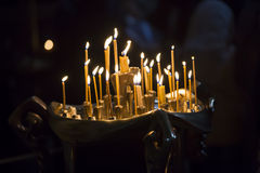The candles in Georgian Church. Long lighted candles group Royalty Free Stock Photo
