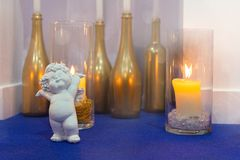 Candles in glass and angel statue. For wedding ceremony stock photos