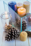 Candles in a glass box. On wooden table Royalty Free Stock Photo
