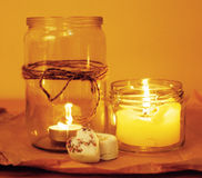Candles in glass burning romantic celebration concept wooden kitchen close up Stock Photography