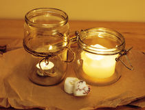 Candles in glass burning romantic celebration concept wooden kitchen close up Royalty Free Stock Photo