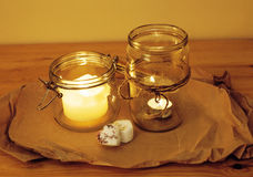 Candles in glass burning romantic celebration Royalty Free Stock Image