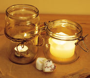 Candles in glass burning romantic celecration concept wooden kitchen Stock Images