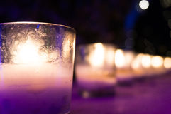 Candles in glass jars put as romantic lamps Stock Photos