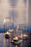Candles in glass jars Royalty Free Stock Images