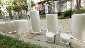 Candles glass in nature stock video footage