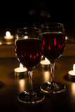 Candles and a glass of wine home evening Stock Photos