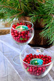 Candles in glasses with cranberries Stock Photos