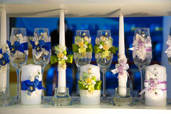 Candles and glasses decorated. With flowers Stock Images