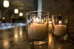 Candles. Glowing in a darkened room Stock Photos