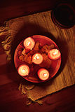 Candles glowing in the Darkness Stock Images