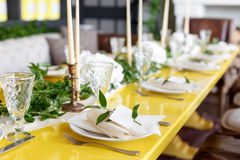 Candles and goblets on a decorated wedding table. selective focus Stock Photography