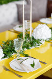Candles and goblets on a decorated wedding table. selective focus Royalty Free Stock Image