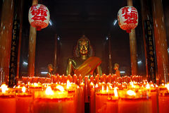 Candles and golden Buddha, Thailand. Stock Photography