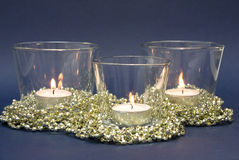 Candles and Golden Decoration Beads Royalty Free Stock Photo