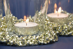 Candles and Golden Decoration Beads Royalty Free Stock Photography