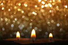 Candles with golden glitter lights Stock Photo