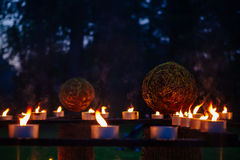Candles, grass and wood fire Festival, pagan Royalty Free Stock Images