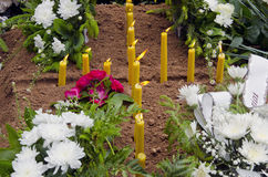 Candles on the grave. Royalty Free Stock Image