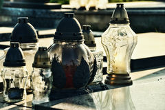 Candles on the grave in the cemetery / graveyard. All Saints Day / All Hallows / 1st November Royalty Free Stock Image