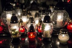 Candles on a grave. At night royalty free stock photos