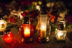 Candles on a grave. At night stock images
