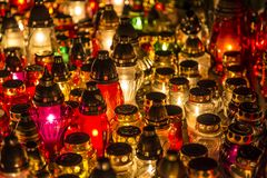 Candles on a grave. At night stock photos