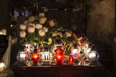 Candles on a grave. At night stock image
