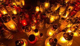 Candles on the graves All Saint's Day Stock Images