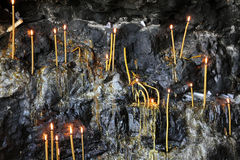 Candles in grotto Stock Photography