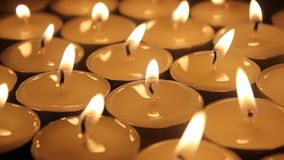 Candles group. Background with candles extinguished with air stock footage
