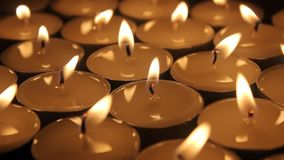 Candles group. Background with candles extinguished with air stock video footage