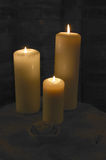 Candle,flame,burning,table,wall. Group of burning candles flames table wall Royalty Free Stock Photo