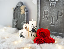 Candles in Halloween decoration and red roses Stock Photography