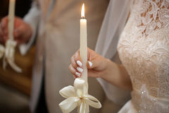 Candles in hand of wedding ceremony Royalty Free Stock Images