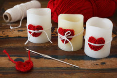 Candles with handmade crochet red heart for Saint Valentine's da Stock Image