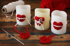 Candles with handmade crochet red heart with skein for Saint Val Stock Image