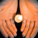 Candles in hands Stock Images