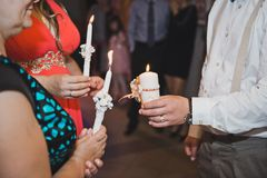 Candles in hands 1756. Stock Photos